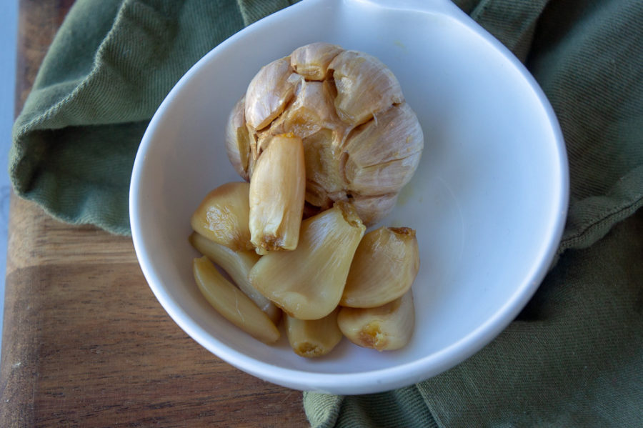 a bowl of roasted garlic cloves