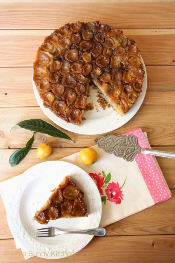 A loquat upside down cake from Little Sunny Kitchen on a wooden table