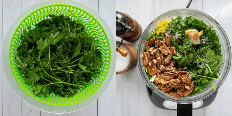 carrot greens in a salad spinner next to a food processor with greens, nuts, and garlic inside