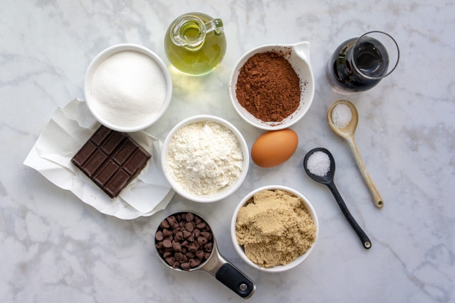 bowls of flour, oil, chocolate and other baking supplies for brownies