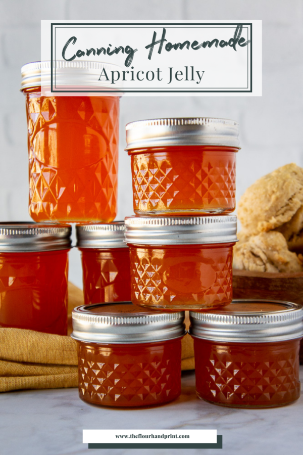 jars of apricot jelly stacked on a table