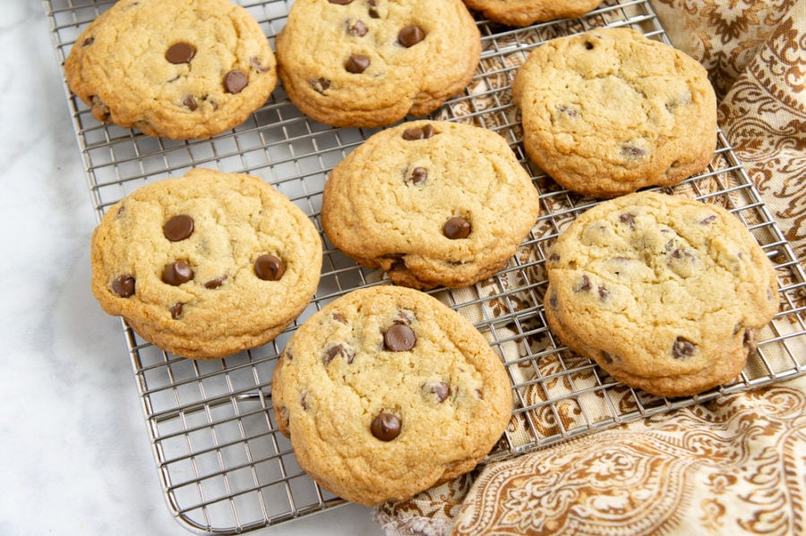 a cooling rack of chocolate chip cookies