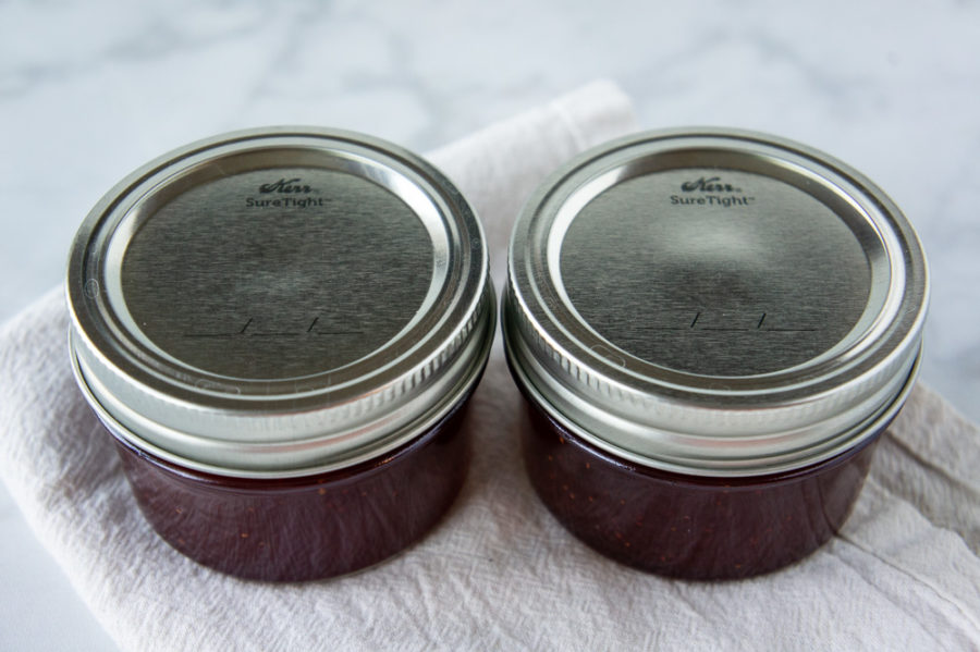 two small jars with one sealed top and one not