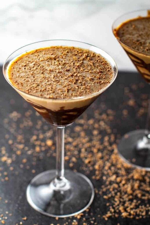 a chocolate martini on a black table