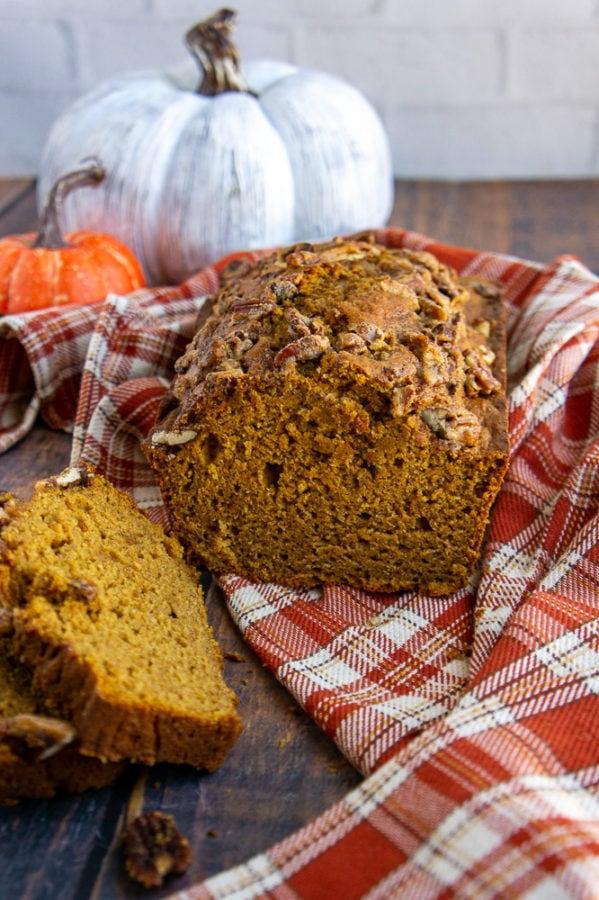 healthy pumpkin bread loaf on a orange checked towel