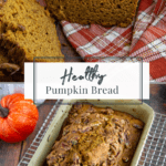 healthy pumpkin bread baked in a loaf pan then sliced open on a fall towel
