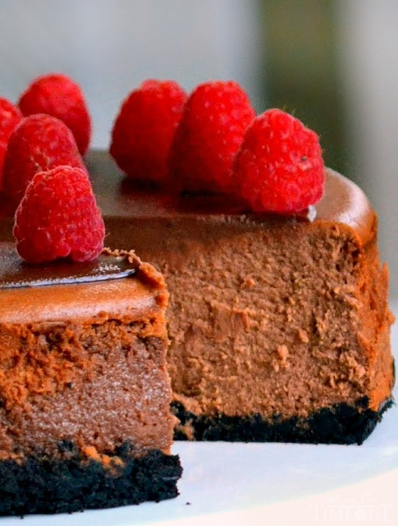 triple chocolate cheesecake with raspberries on top