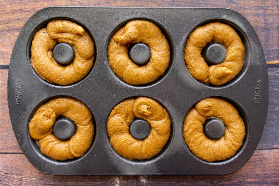 baked pumpkin donut batter in a pan