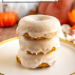 a stack of white glazed baked donuts