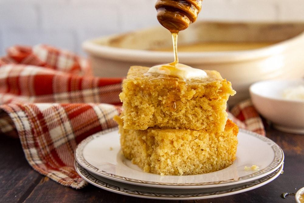 a stack of honey butter cornbread